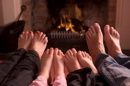 four-family-feet-by-fireplace