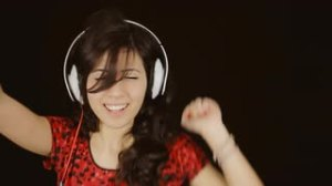 wpid-music-woman-headphones-black-shake-it-off-a-beautiful-young-woman-dancing-and-listening-to-music-with-headphones-feeling-crazy-as-the-rhythm-grows-shaking-her-body-in-a-frenzy-close-up-shot-on-red-background_mj5o8kxv__s0000.jpg