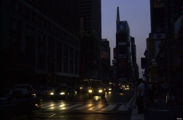 Times Square is plunged into darkness as the sun goes down a